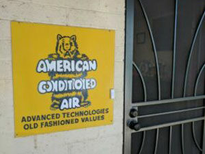 American Conditioned Air sign -- air conditioner maintenance