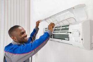 Man installing air conditioner wall unit